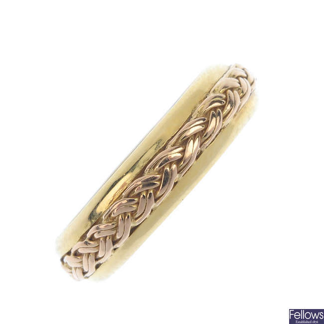 CLOGAU - an 18ct gold band ring.