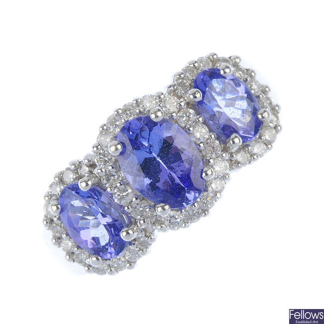 An 18ct gold tanzanite and diamond triple cluster ring.