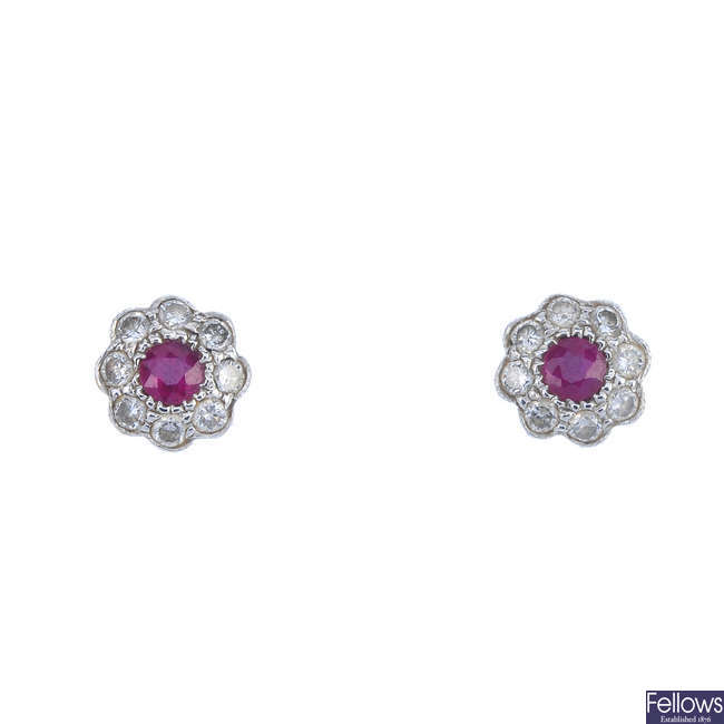 A pair of 18ct gold ruby and diamond cluster earrings and a brooch.