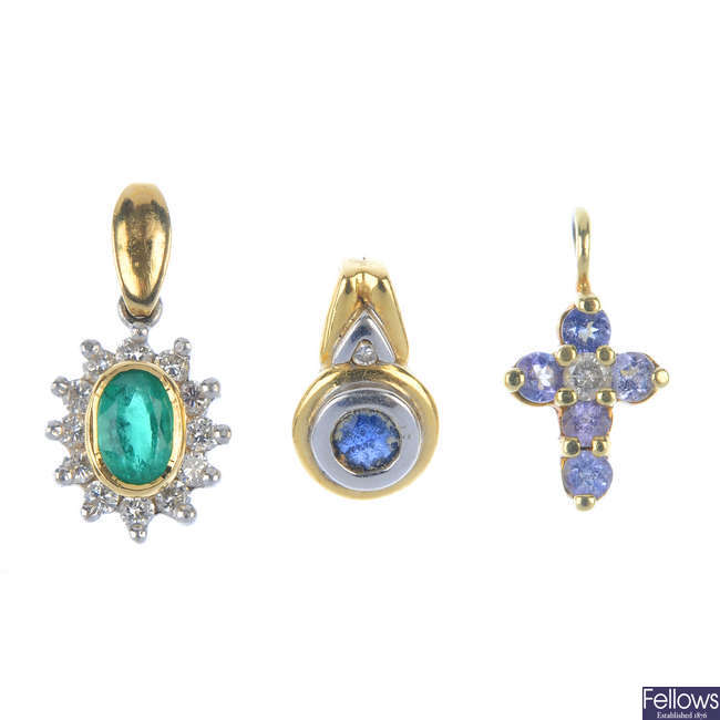 A selection of three diamond and gem-set pendants.