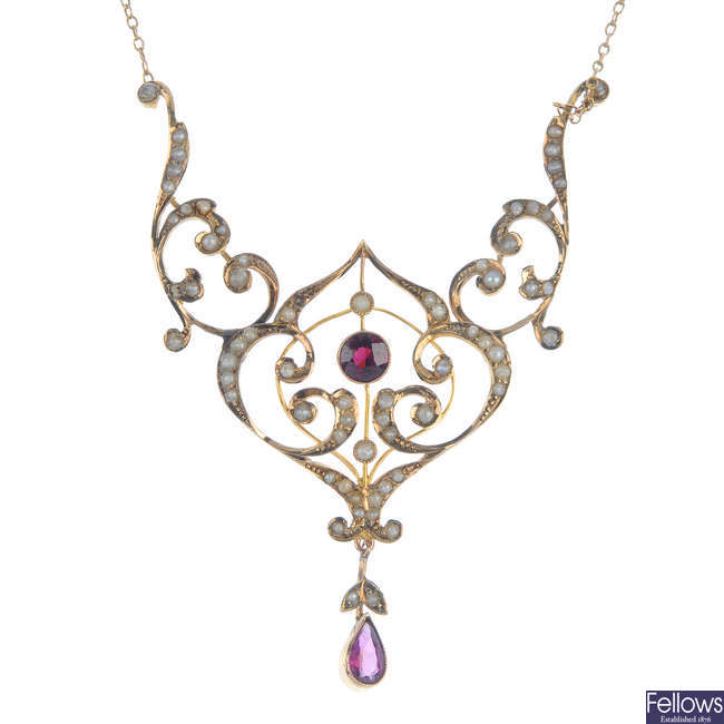 An early 20th century 9ct gold, garnet and split pearl necklace.