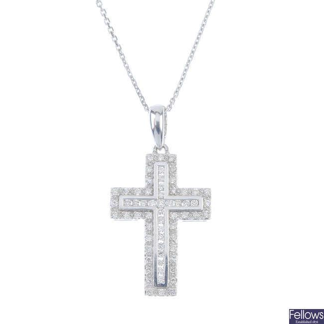 An 18ct gold diamond cross pendant, with chain.