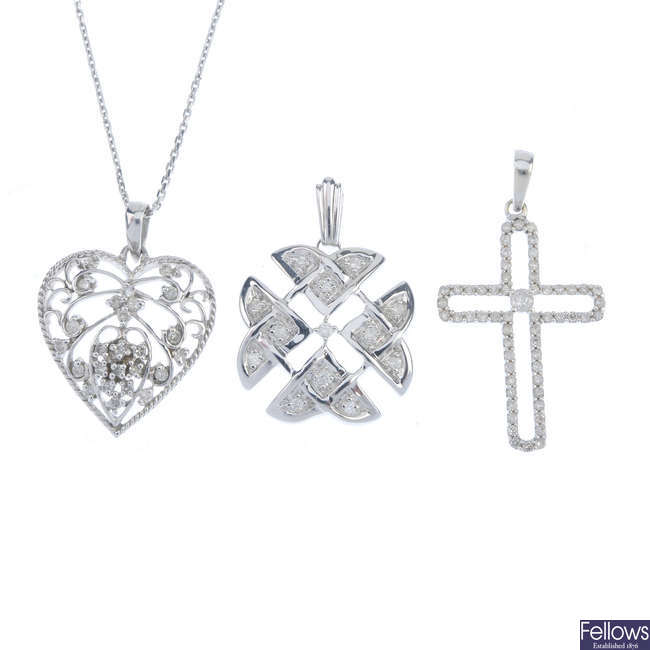 A selection of three 9ct gold diamond pendants, with chain.