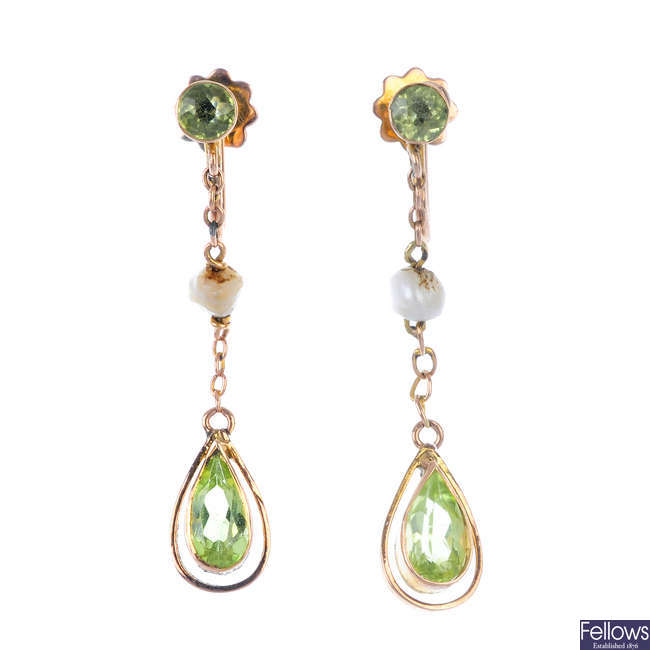 A pair of early 20th century 9ct gold peridot and seed pearl ear pendants.