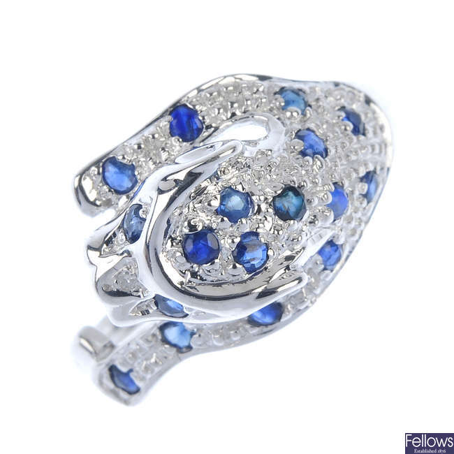 A 9ct gold sapphire and diamond panther ring.