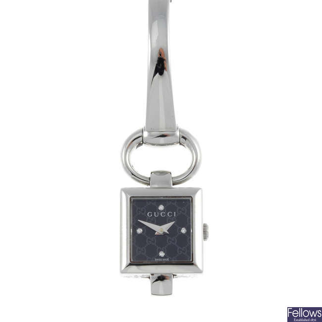 GUCCI - a lady's stainless steel 120 bracelet watch.