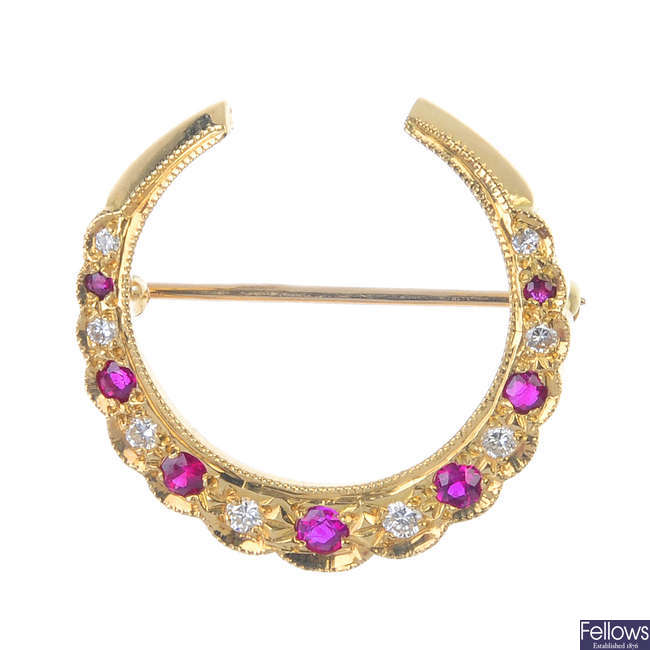 An 18ct gold ruby and diamond brooch.