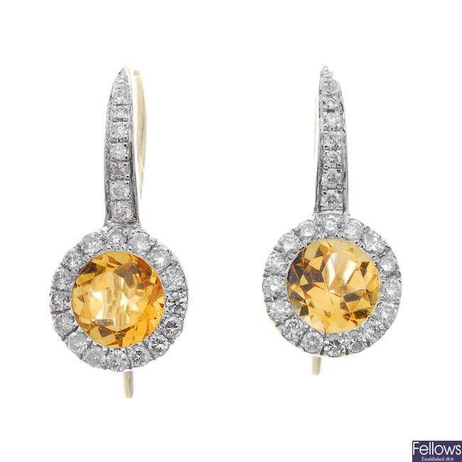 A pair of citrine and diamond ear pendants.