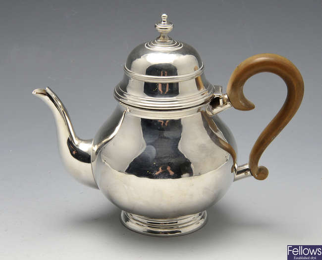 An Edwardian silver teapot, retailed by Harrods.