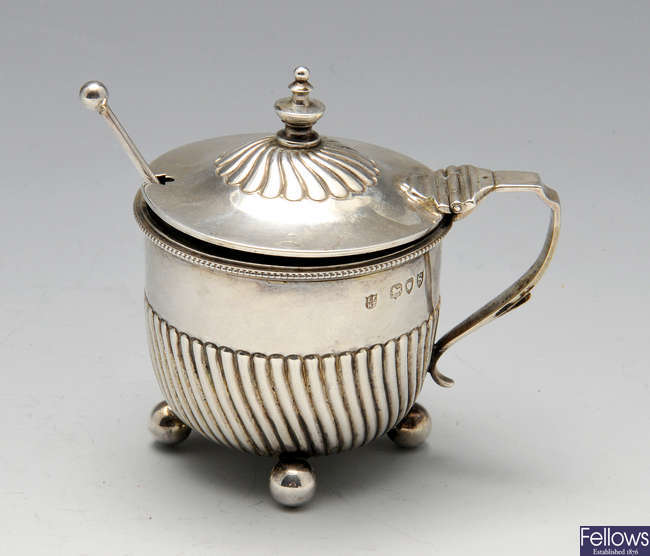 A late Victorian silver mustard pot, plus a pair of butter dishes and a porringer.