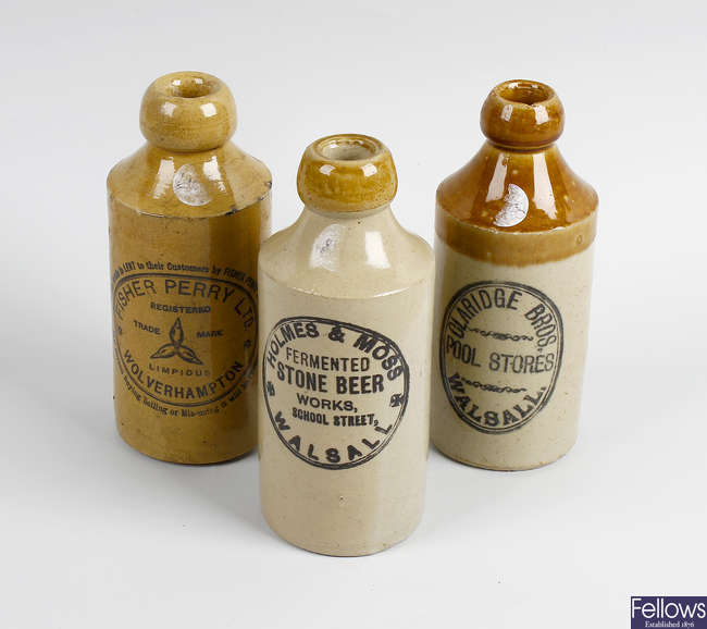 Two boxes containing a large collection of assorted pottery bottles