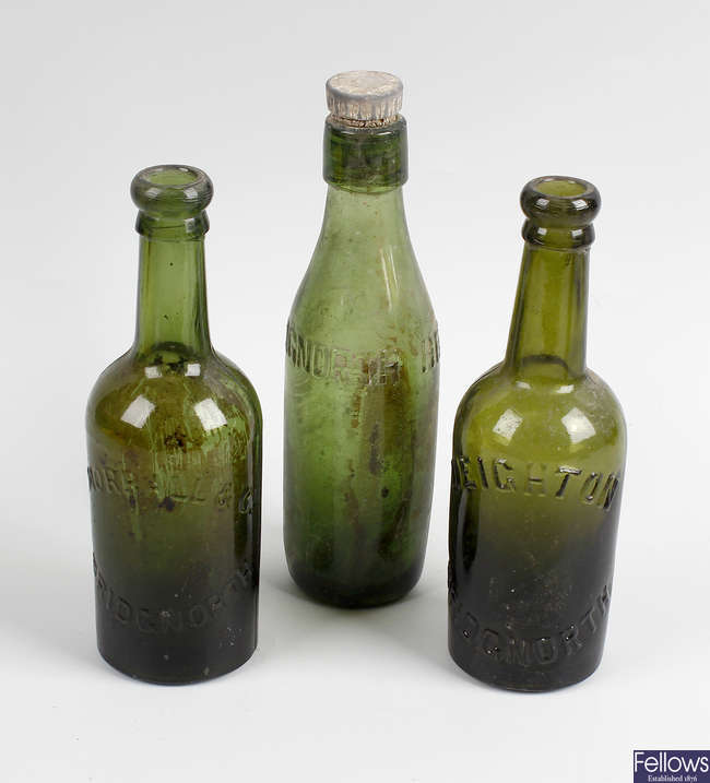 Two boxes containing a large collection of assorted glass bottles