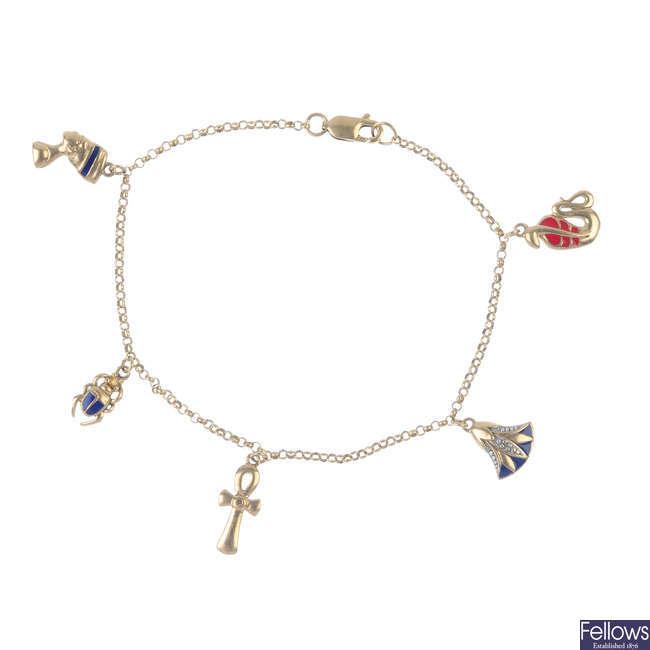 An enamel and diamond charm bracelet.