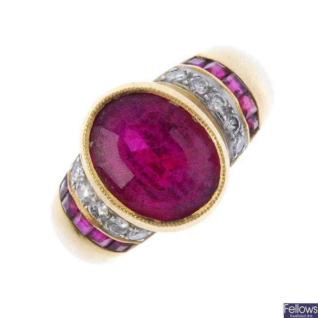 A tourmaline and diamond dress ring.