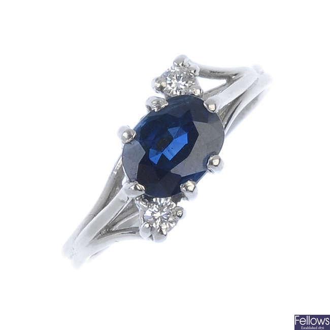 A platinum sapphire and diamond three-stone ring.