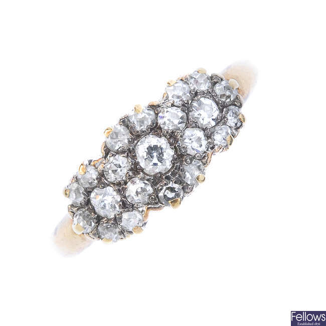A mid 20th century 18ct gold diamond triple cluster ring.