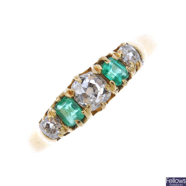 An early 20th century 18ct gold diamond and emerald five-stone ring.