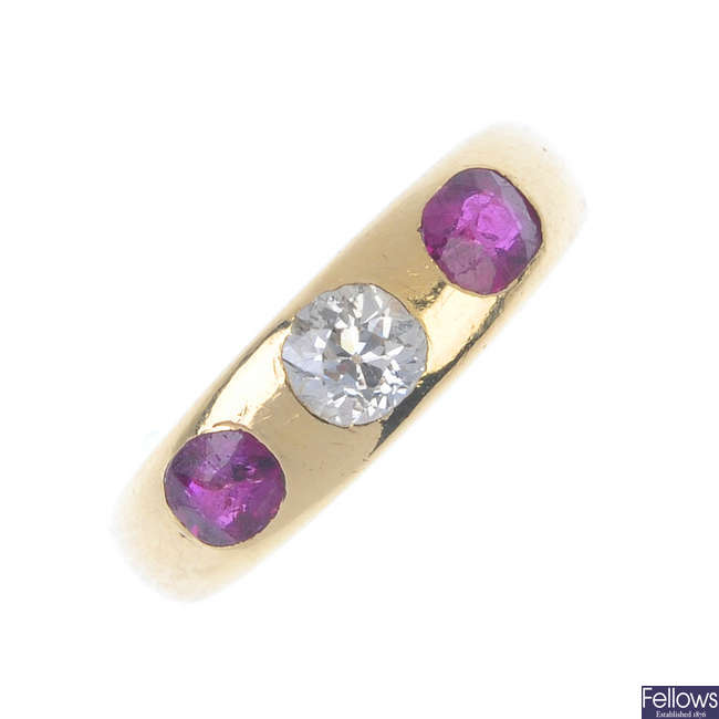 An early 20th century 18ct gold ruby and diamond three-stone ring.