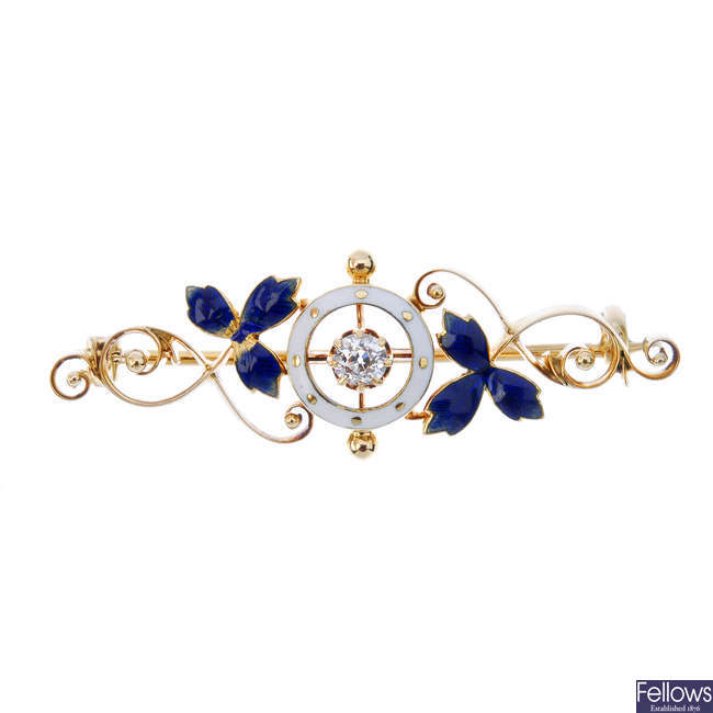 An early 20th century 15ct gold diamond and enamel bar brooch.