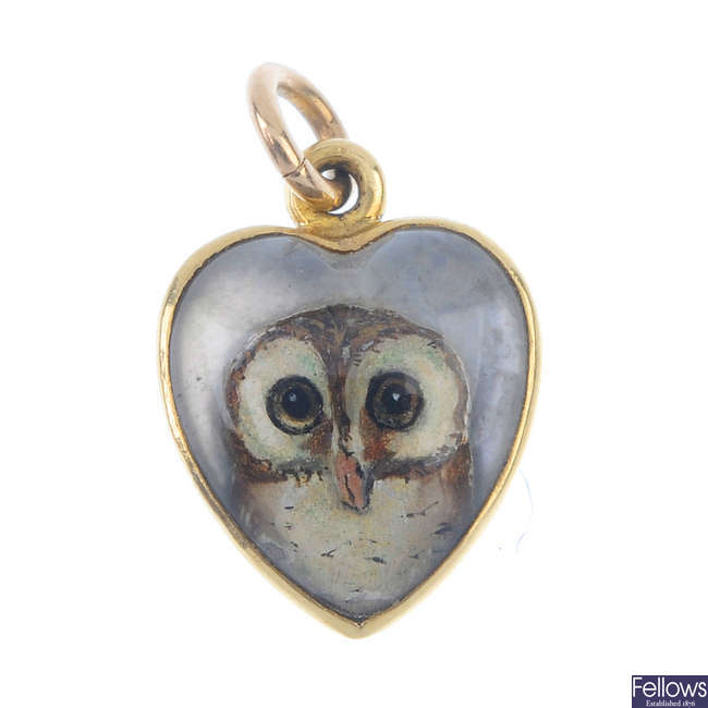A late 19th century gold reverse carved intaglio owl pendant.
