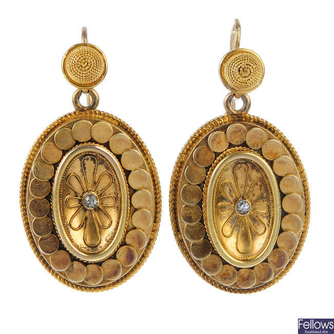 A pair of gold floral ear pendants.