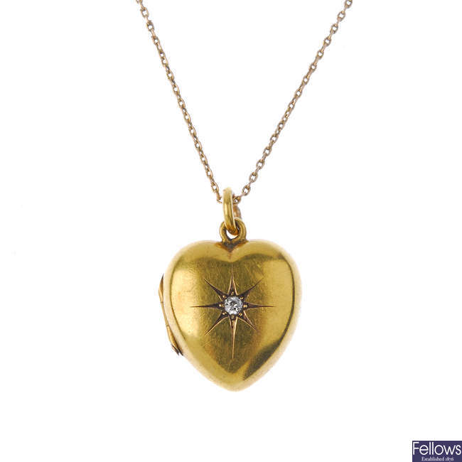 An early 20th century 15ct gold diamond heart locket.
