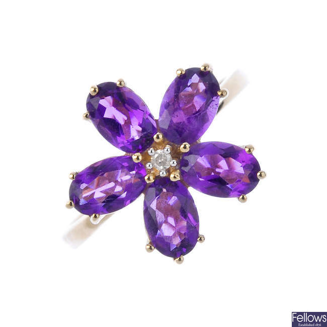A 9ct gold amethyst and diamond floral cluster ring.