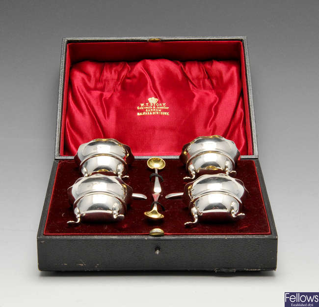 A cased set of four Edwardian silver open salts and spoons.