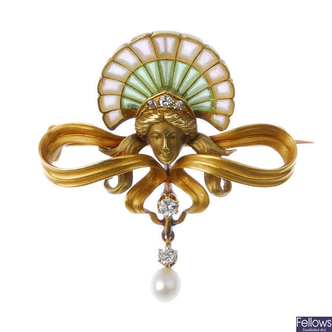 An Art Nouveau gold diamond, pearl and plique-a-jour brooch.
