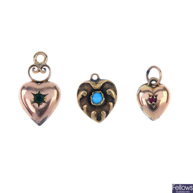 A selection of seven gem-set and paste heart pendants.