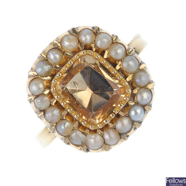 A topaz and split pearl cluster ring
