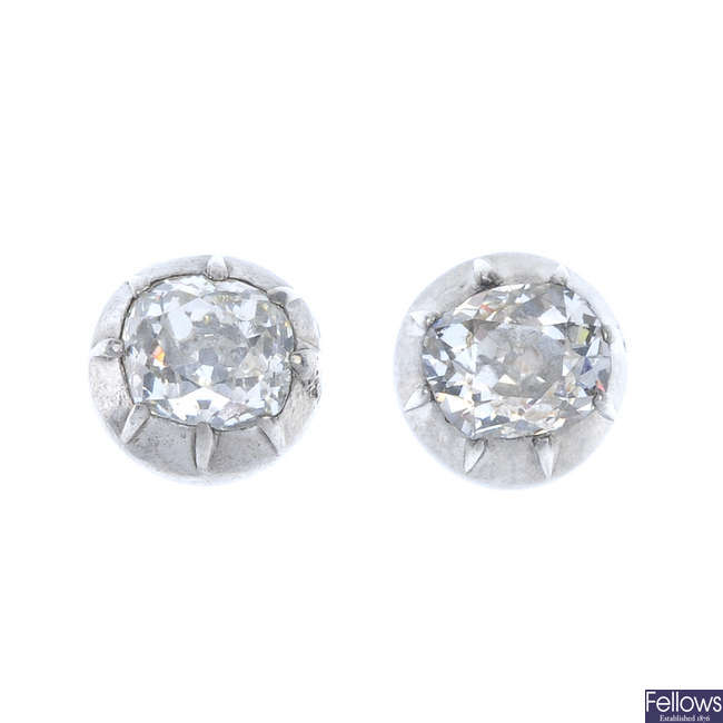 A pair of diamond single-stone ear studs.
