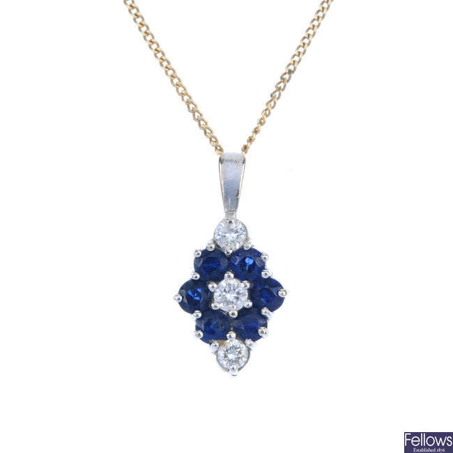 An 18ct gold diamond and sapphire pendant and chain.