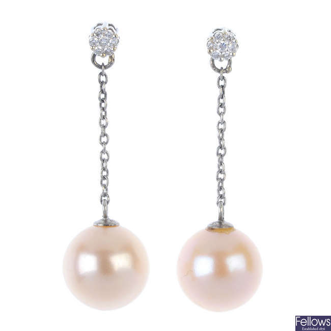 A pair of cultured pearl and diamond ear pendants.