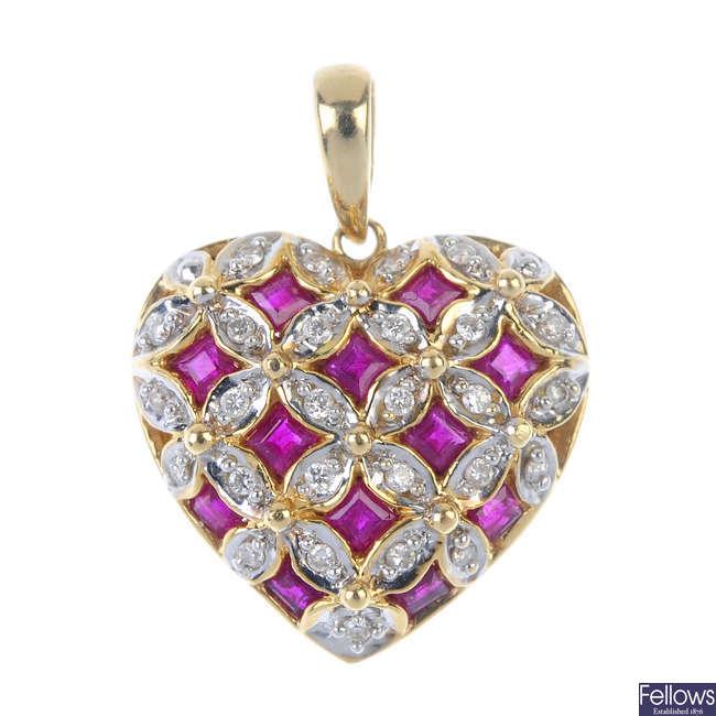 A ruby and diamond heart pendant.