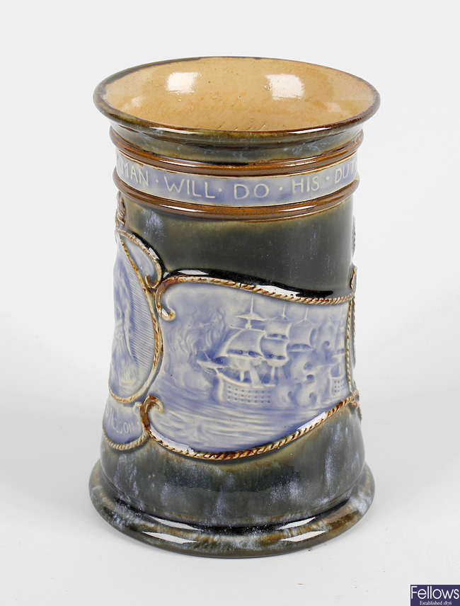 A commemorative Royal Doulton stoneware beaker
