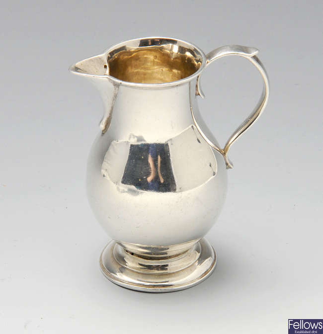 A George II silver sparrow-beak cream jug.