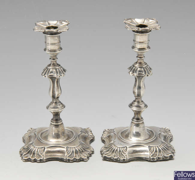 A pair of Edwardian silver tapersticks.
