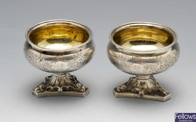A pair of Victorian silver salts with triangular feet.