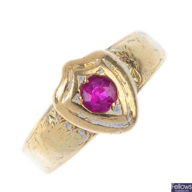 A synthetic ruby dress ring.