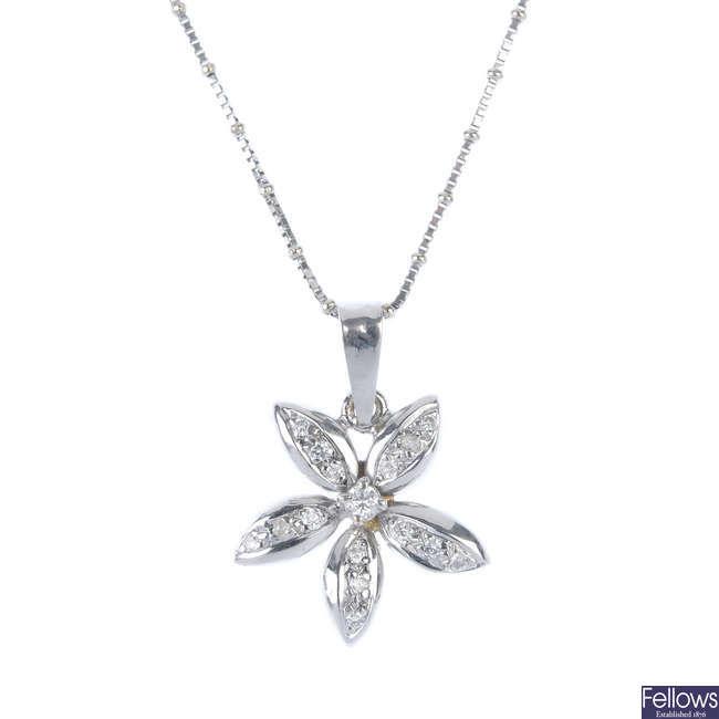 A diamond flower pendant.