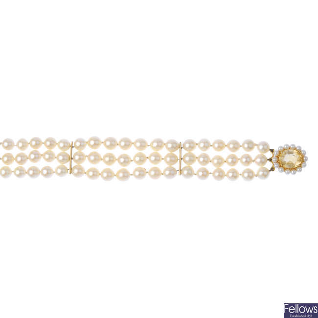 A cultured pearl three-row bracelet, with 9ct gold gem-set clasp.