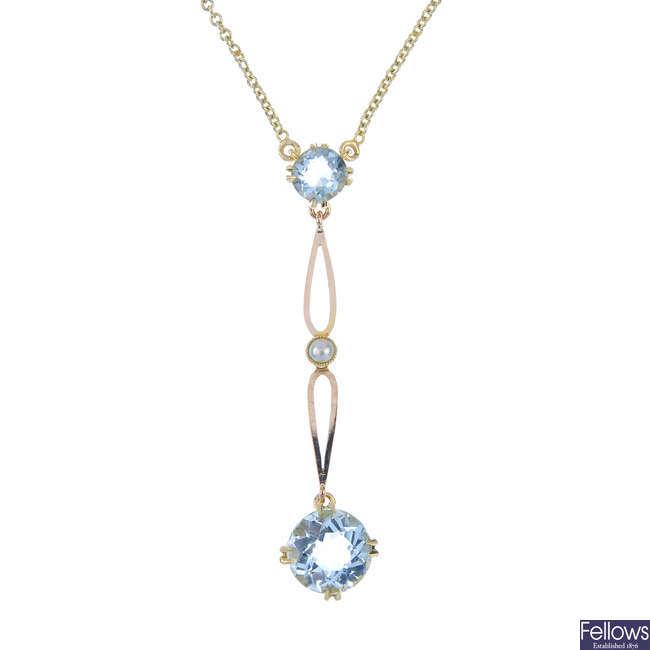 An aquamarine and split pearl pendant.