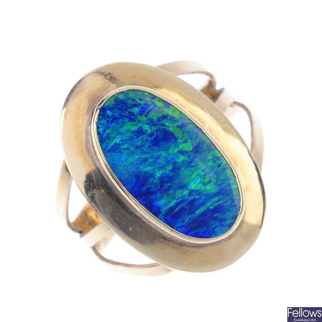 An opal doublet single-stone ring.