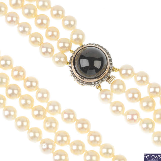 A cultured pearl three-row necklace, with garnet and rose-cut diamond clasp.