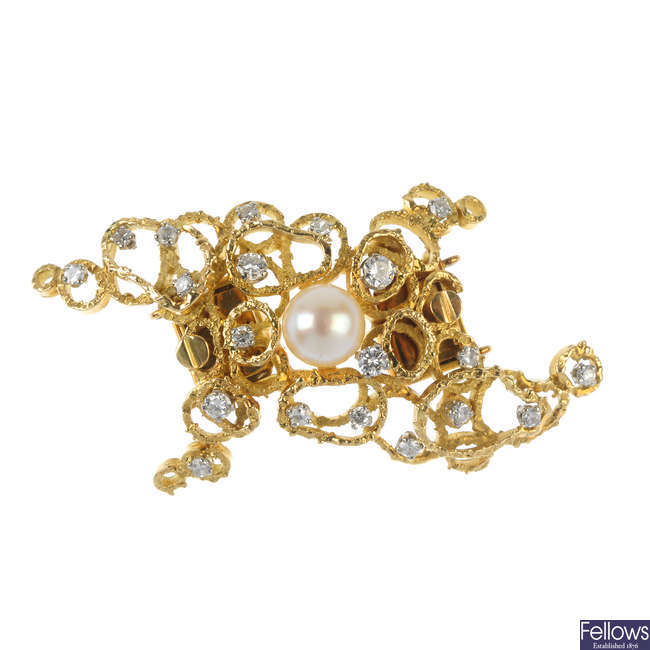 A 1970s cultured pearl and diamond clasp.
