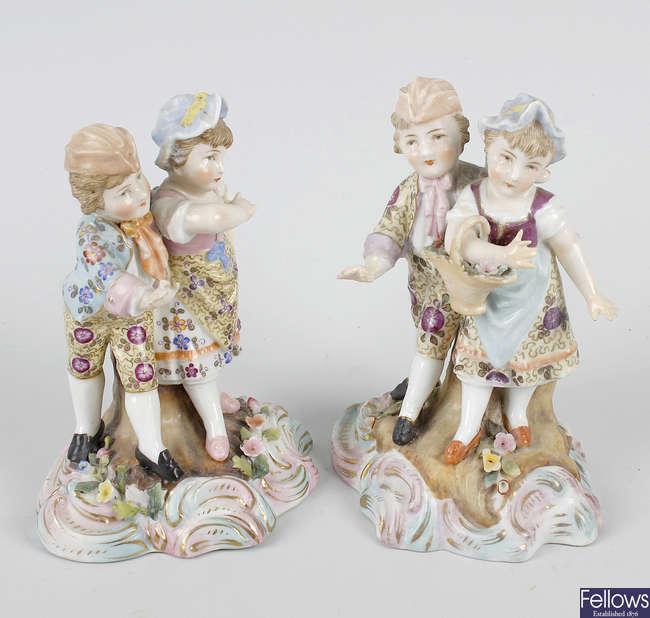 A pair of German porcelain figures of couples