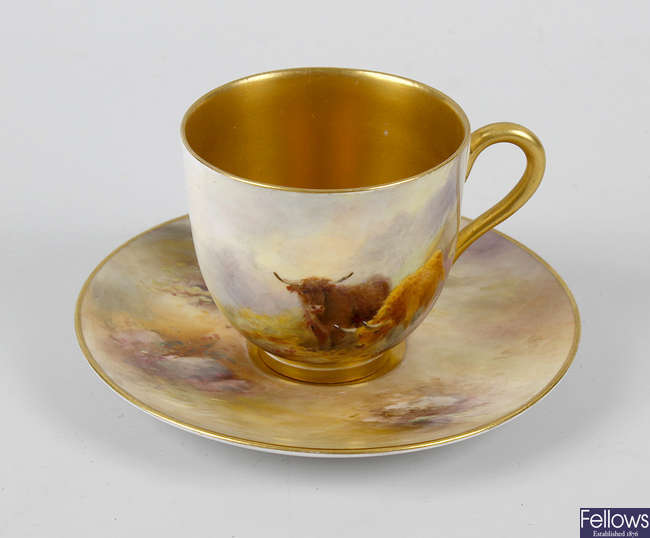 A Royal Worcester hand painted cup and saucer
