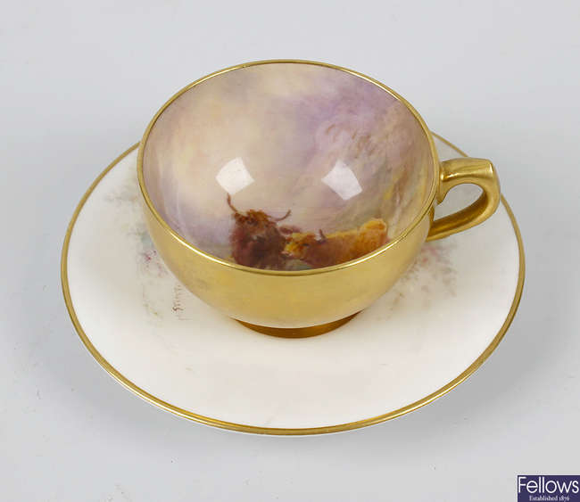 A Royal Worcester hand painted coffee cup and saucer