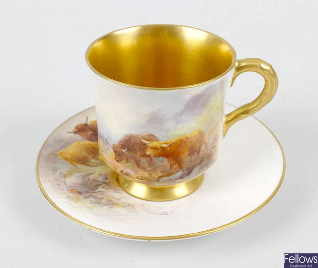 A Royal Worcester hand painted waisted cup and saucer
